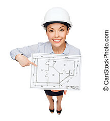 businesswoman in helmet showing with blueprint