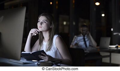 Businesswoman in her office at night working late. -...