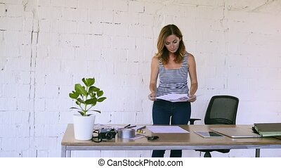 Businesswoman in her office with a tablet.