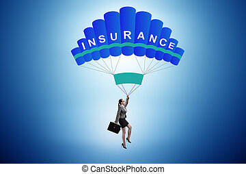 Businesswoman in insurance concept on parachute