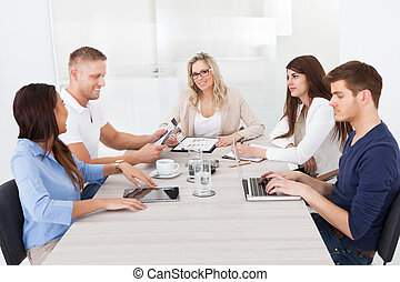 Businesswoman In Meeting With Colleagues
