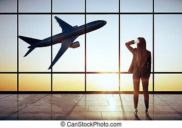 Businesswoman in modern airport interior