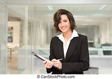 Businesswoman in modern office interior