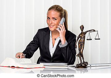 businesswoman in office - businesswoman sitting in an...