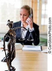 businesswoman in office - businesswoman sitting in an office...