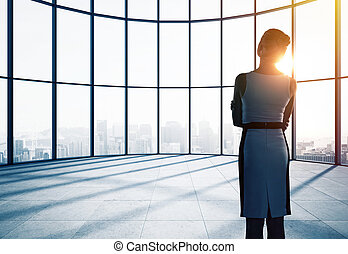 businesswoman in office - businesswoman thinking in office...