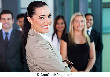 businesswoman in office with co-workers
