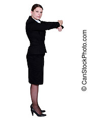 businesswoman in profile making gesture with fists