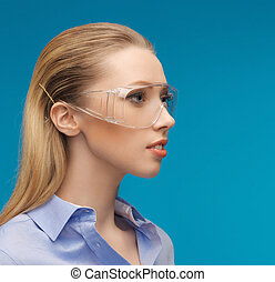 businesswoman in protective glasses - bright picture of...
