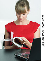 Businesswoman in red with magazine