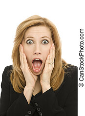 Businesswoman in shock - A businesswoman in a suit gestures ...