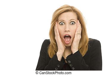 A businesswoman in a suit gestures surprise