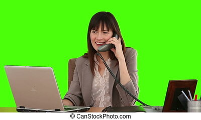 Businesswoman in suit working at her desk