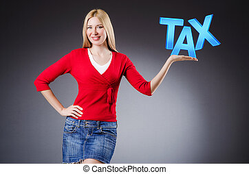 Businesswoman in tax business concept