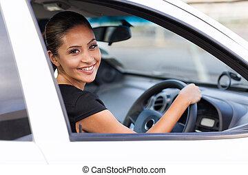 businesswoman inside a new car