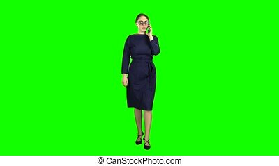Businesswoman is going to a meeting and talking on the phone. Green screen