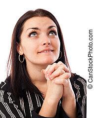 businesswoman, jonge, op, het kijken, terwijl, biddend