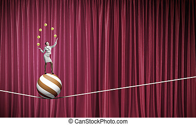 Businesswoman juggling with balls