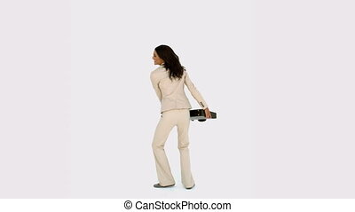 Businesswoman jumping and holding h