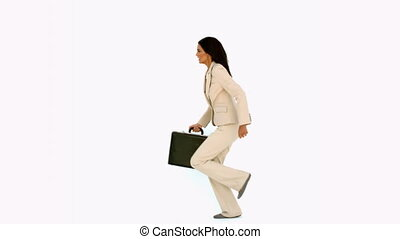 Businesswoman jumping in the air wi