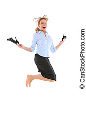 businesswoman jumping with shoes in hand