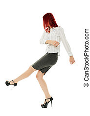 Businesswoman kicking out