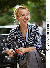 Businesswoman laughing at lunch