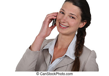 Businesswoman laughing on a mobile phone