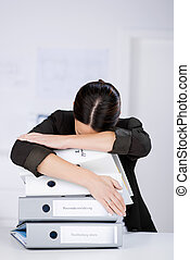 Businesswoman Leaning On Stack Of Binders