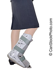 Businesswoman leg with an ankle brace over white