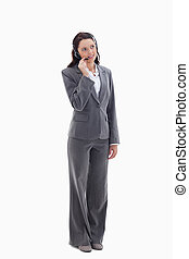 Businesswoman listening with a headset against white...