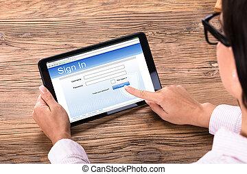 Businesswoman Login On Digital Tablet