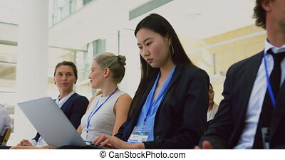 Businesswoman looking at camera during seminar 4k - Front ...