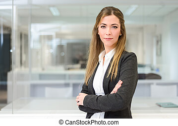 Businesswoman looking at camera in an office