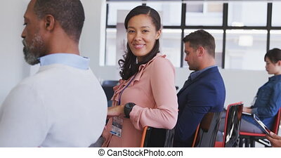 Businesswoman looking at camera in conference room - ...