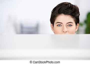 Businesswoman Looking At Camera In Cubicle