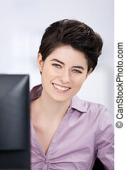 Businesswoman Looking At Camera In Office