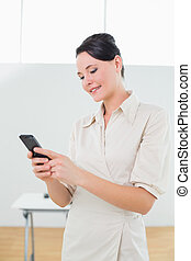 Businesswoman looking at cellphone