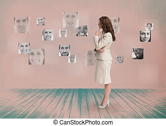 Businesswoman looking at digital interface in black and white