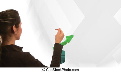 Business woman looking at a 3D graph