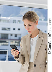 Businesswoman looking at her smartphone