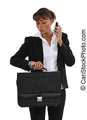 Businesswoman looking at her watch