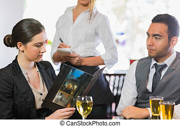 Businesswoman looking at menu
