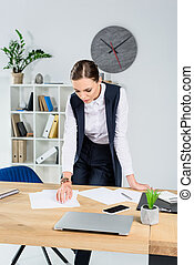 businesswoman looking at paperwork