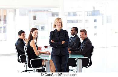 Businesswoman looking at the camera in a meeting