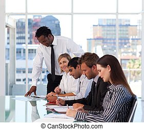 Businesswoman looking at the camera working together with her team