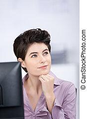 Businesswoman Looking Away In Office