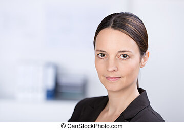Businesswoman Looking In Camera In Office