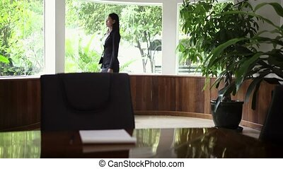 Businesswoman looking out of window - Beautiful Asian female...