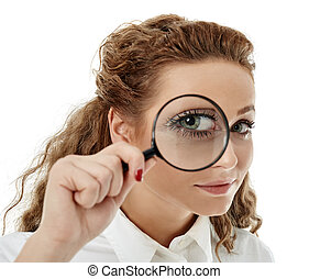 Businesswoman looking through a loupe